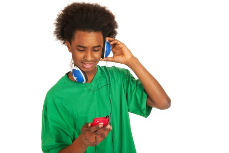 Black boy is listening to music from his smartphone photo
