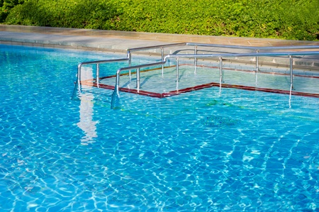staircases: Outdoor swimming pool with staircases