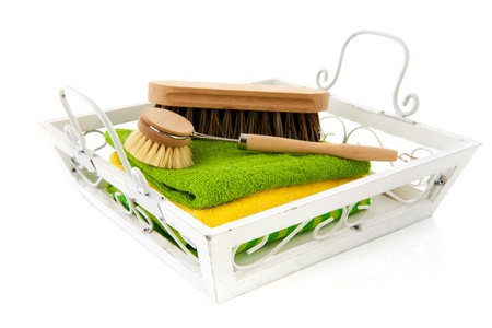 white tray with brushes and cleaning clothes photo