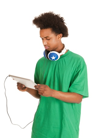 Black boy is having tablet and headphones photo