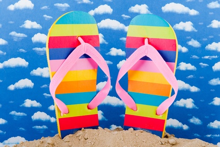 Colorful flip flops at the beach Stock Photo - 13476037
