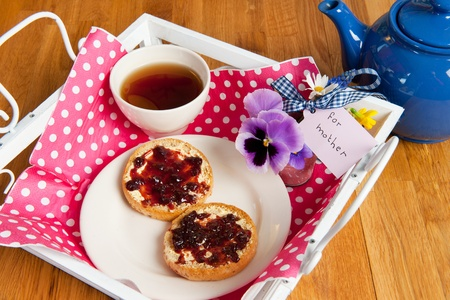 Tray with breakfast for mother with tea and biscuits photo