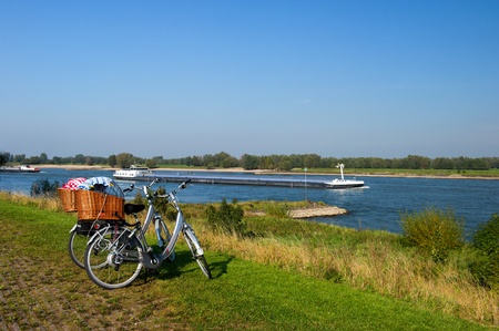 Big cargo boat on the Dutch river and parked bicycles Stock Photo - 13472897