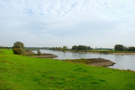 breakwaters: Dutch river the IJssel with breakwaters Stock Photo