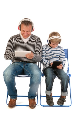 Father and son are together gaming with tablet PC photo