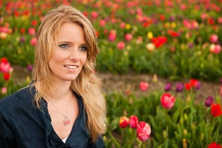 dutch girl: Portrait of a beautiful blond Dutch girl in tulips fields