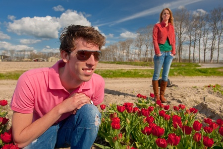 Young couple tourists are visiting the Dutch flowers fields Stock Photo - 13476034