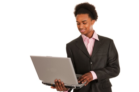 Black business man with laptop isolated over white background photo