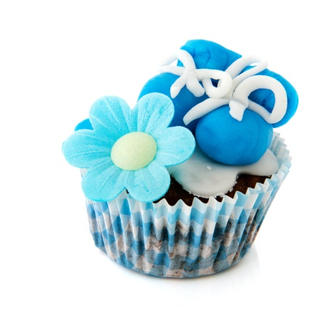 Blue cupcake with baby shoes and hearts photo