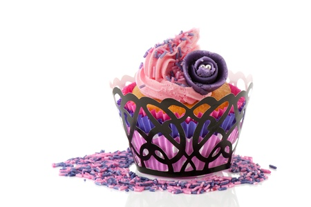 marzipan: Pink cupcake with marzipan purple rose flower and sprinkles