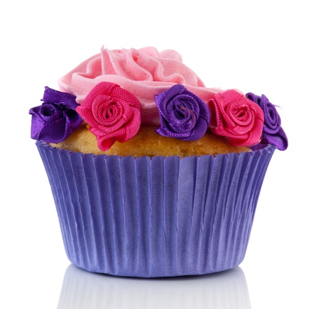 cupcakes isolated: Purple and pink cupcake isolated over white background