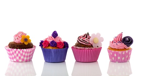 Colorful row cupcakes with flowers and pink butter cream