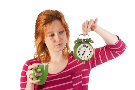 Young woman is enjoying het morning coffee while wake up very early Stock Photo - 13636750