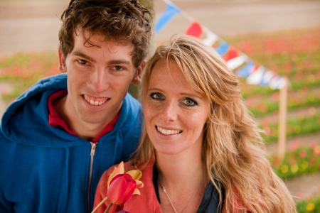 Young couple in Holland with Dutch flower fields photo