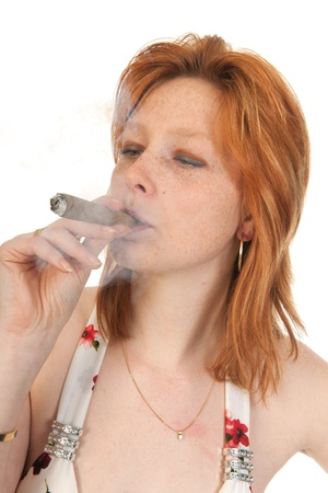 Portrait of an young woman smoking a cigar photo