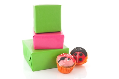Child birthday presents and funny cupcakes Stock Photo - 13726563