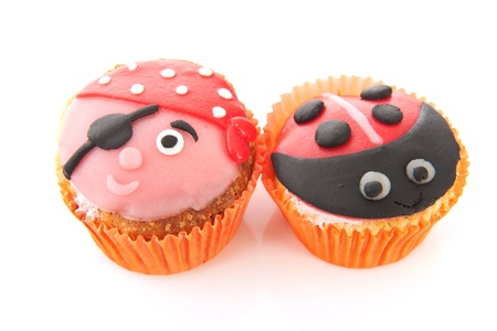 Colorful cupcakes with child decoration as pirate and ladybug photo