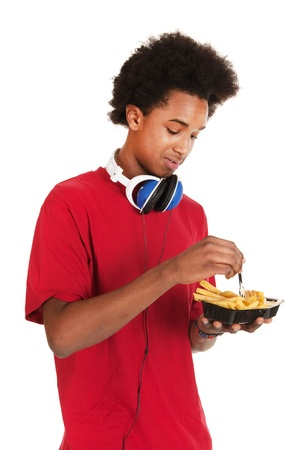 Black teenage boy is eating French fries Stock Photo - 13712825