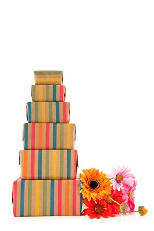 colorful stack with wrapped presents and flowers isolated on white background Stock Photo - 13727271