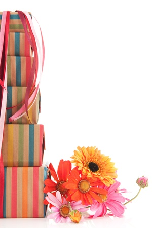 colorful stack with wrapped presents and flowers with copy space Stock Photo - 13727290