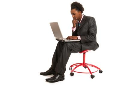 black business man: Jeune homme d'affaires noir avec un ordinateur portable en studio Banque d'images