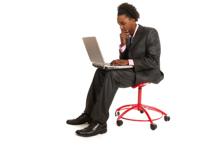 Young black business man with laptop in studio photo