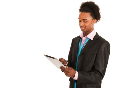 Young black business man with tablet PC in studio photo