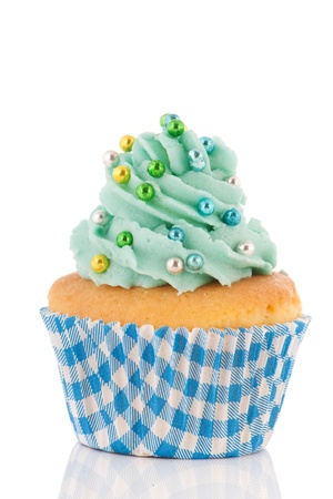 Cupcake in blue paper wrapped with green butter cream