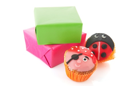Child birthday presents and funny cupcakes Stock Photo - 13863436