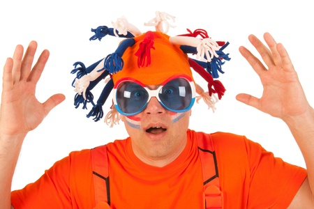 Man in orange with funny hat and orange cloths Stock Photo