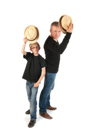 sturdy: Sturdy father and son with hats making performance