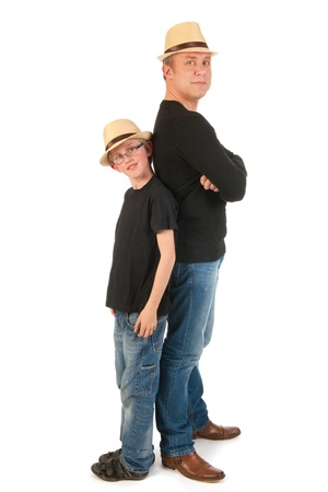 sturdy: Sturdy father and son standing in the studio Stock Photo