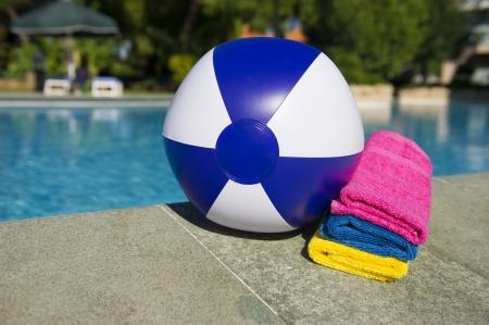 beachball: Beachball and towels near the outdoor swimming pool