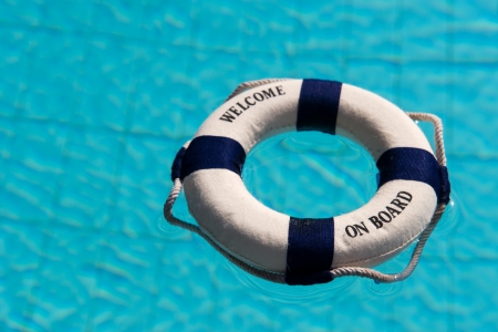 Life buoy floating in the outdoor swimming pool photo