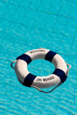 Life buoy floating in the swimming pool  photo
