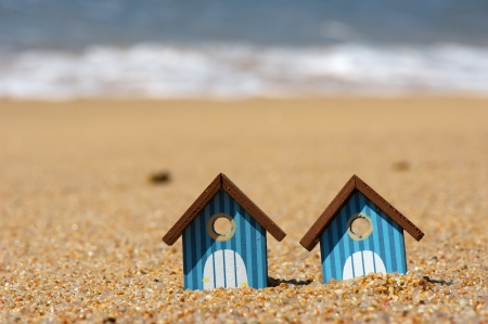 Miniature beach huts at the beach photo