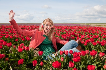 dutch girl: Dutch girl with long blond hair is listening to music