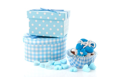 Baby boy cupcake and presents in blue photo