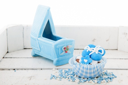 gumpaste: Blue cupcake with baby shoes and craddle