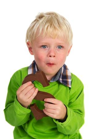 sinterklaas: Little child is eating Dutch chocolate Sinterklaas letter