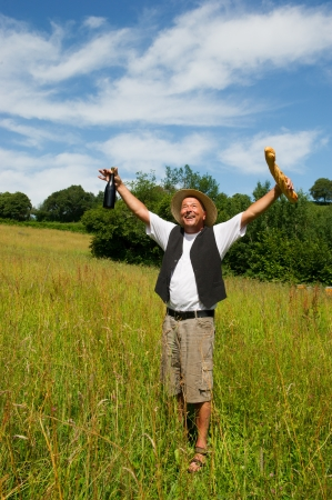 Typical French man in nature happy with bread and wine photo