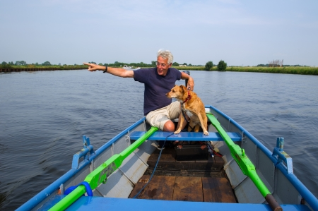 eem: Man with dog in whisperboat at Dutch river
