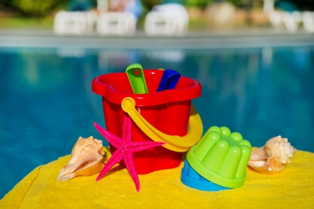 Toys for vacation with childeren near swimming pool photo