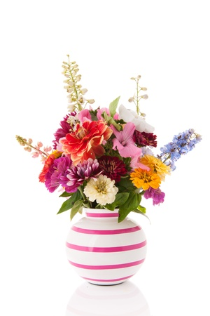 Striped vase with mixed garden flowers photo