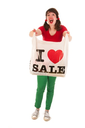 Young woman is loving sales while shopping Stock Photo - 14697742