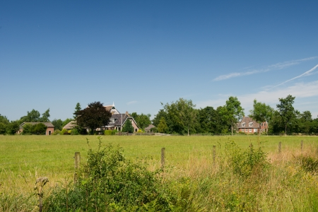 friesland: Typical Dutch farmhouses in landscape at Friesland Stock Photo