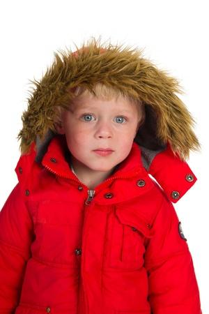 Little boy child in red winter coat photo