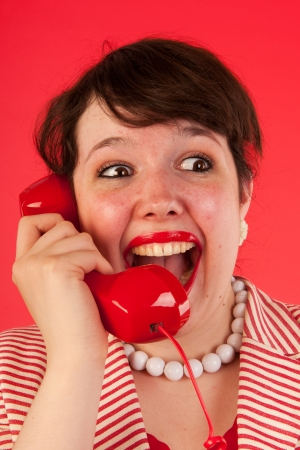 Young woman is having good news on the phone Stock Photo - 14939903