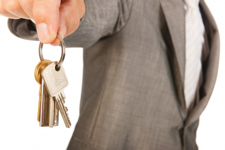 Broker is holding bunch of keys for opening your house photo