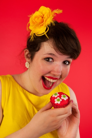 colorful portrait of woman eating cupcake photo